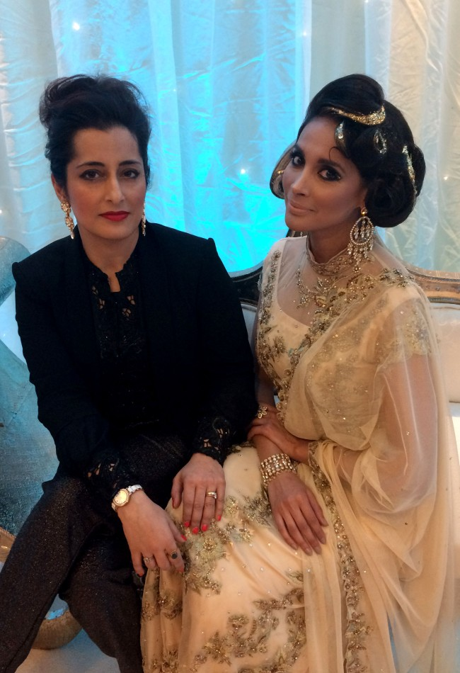 Raishma With A Model  Dressed In One Her Evening Outfits At The Asiana Bridal Show